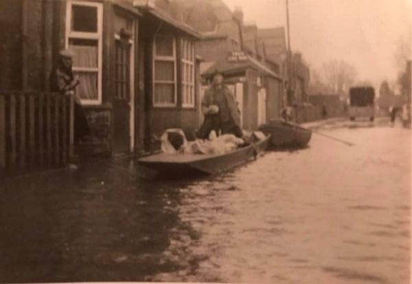 Man in a boat outside the pub