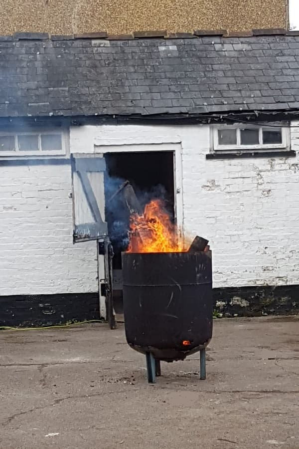 Brazier is being used to burn worst of the rotten wood