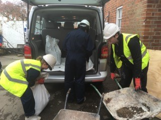 Loading up soil to be taken to the allotments