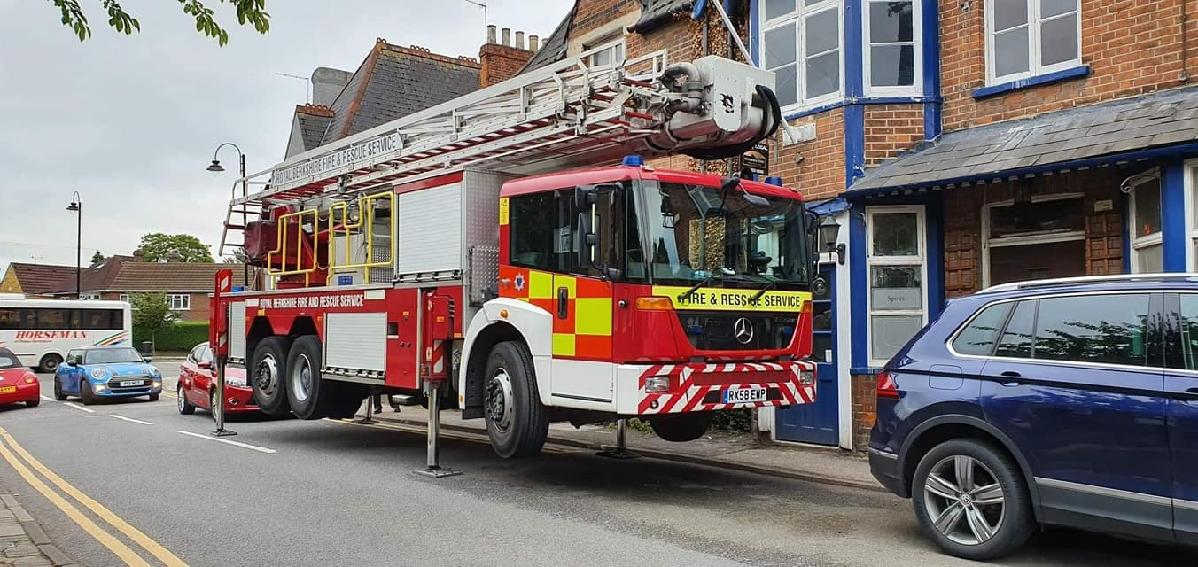 Fire engine slotted in between parked cars