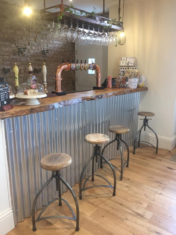 Stools in front of the new bar, also shows new lightly coloured wooden floor