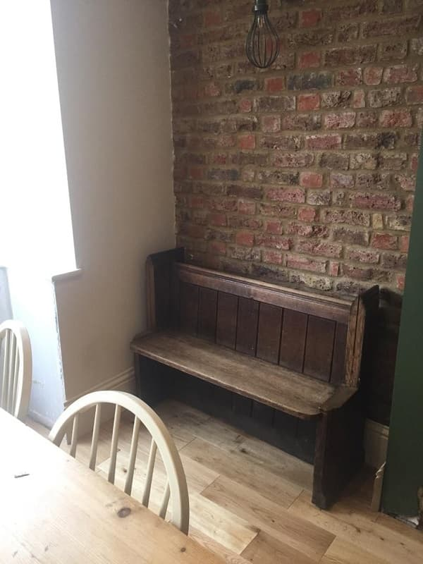 Old fashioned pew fitted into one of the alcoves