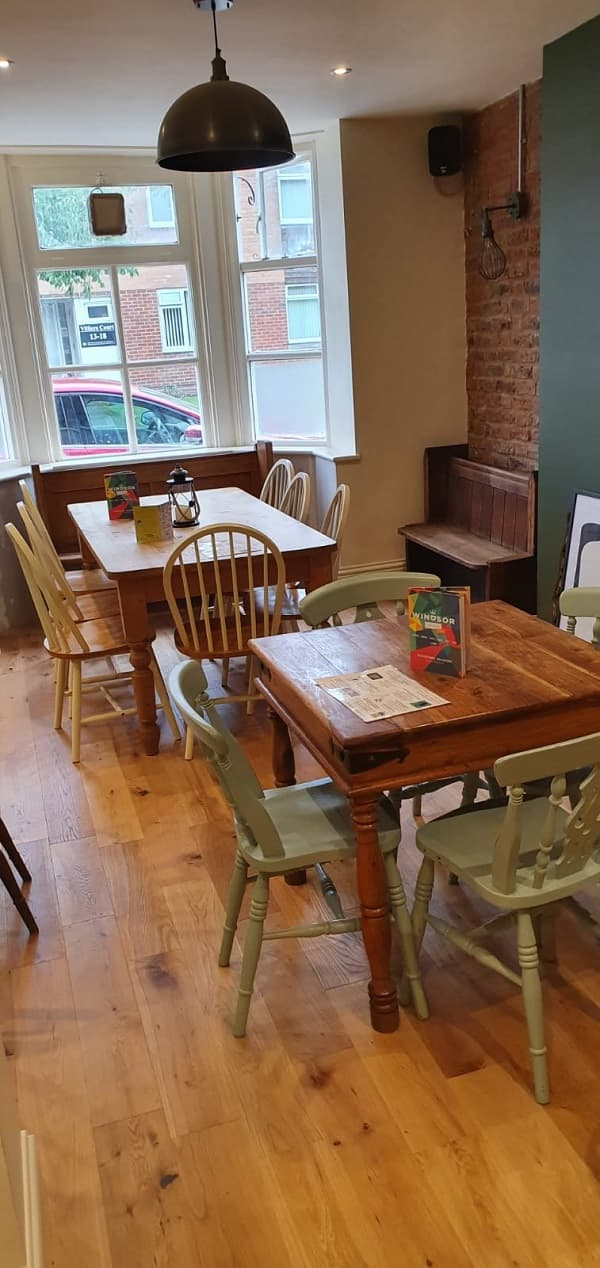 Tables and painted chairs on the new wooden floor