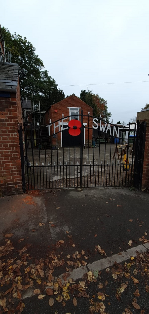 Large poppy mounted on the front gates