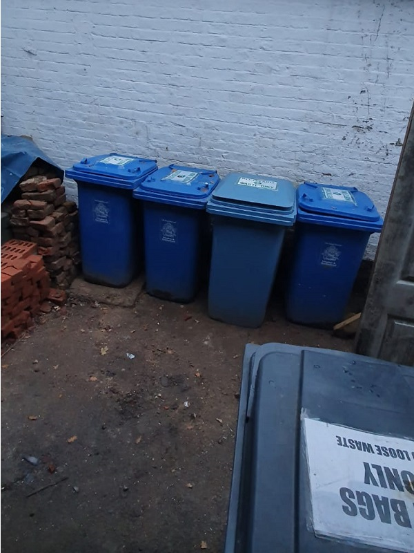 Five recycling bins all in view