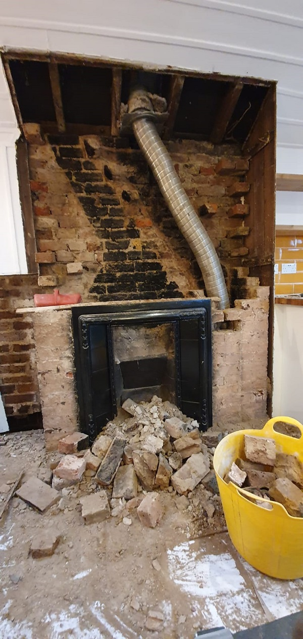 Chimney breast being removed in school room