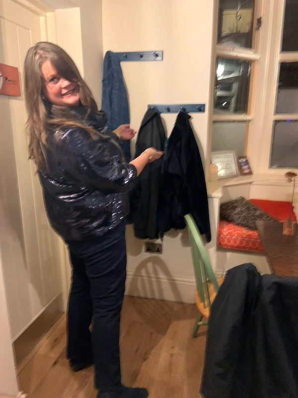 Louise demonstrating how to use the new coat hooks