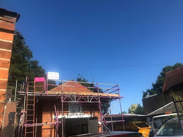Blue sky above The Coach House, new scaffolding up