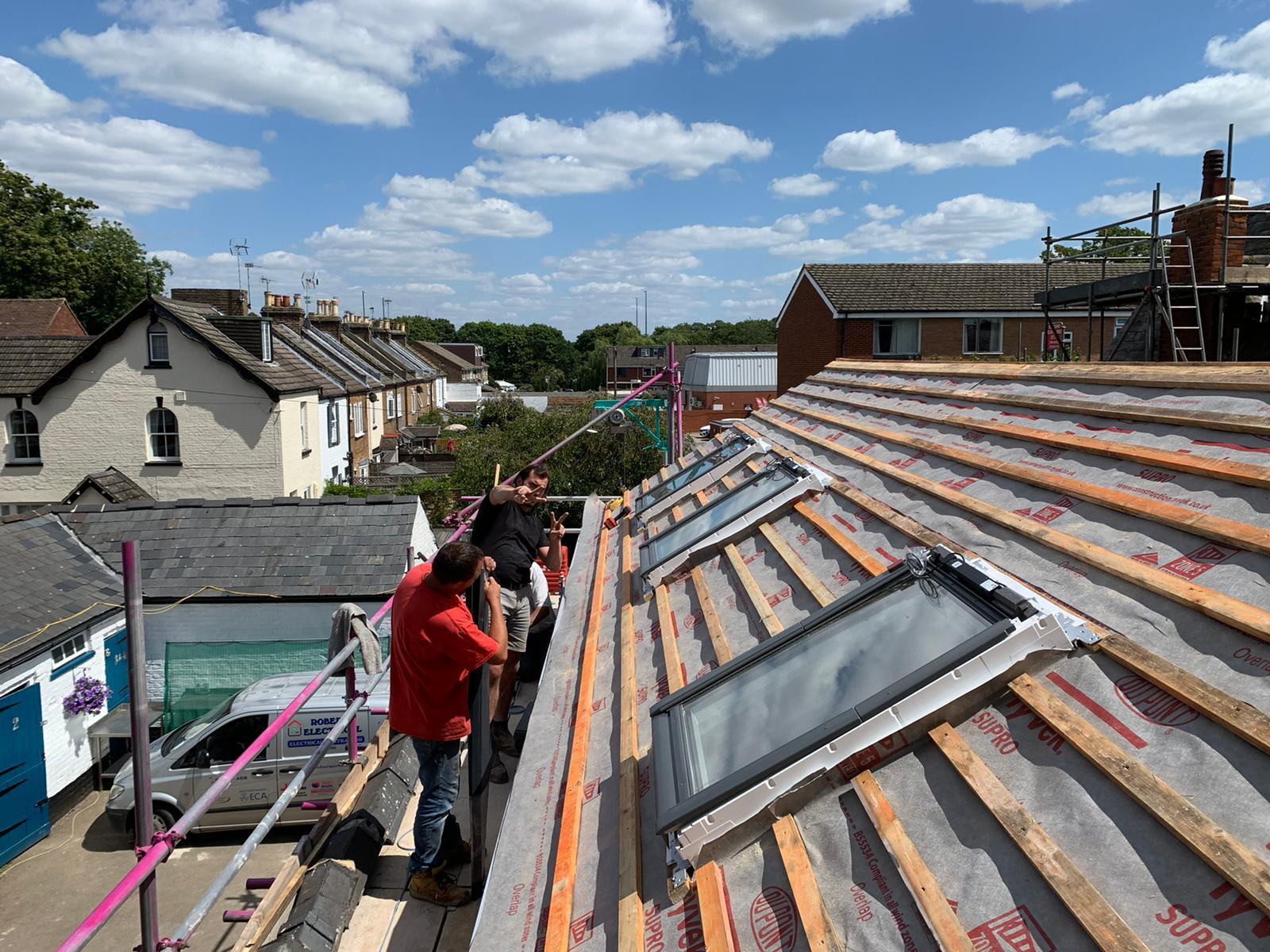 Coach House roof with the Jayflex team working in the velux windows