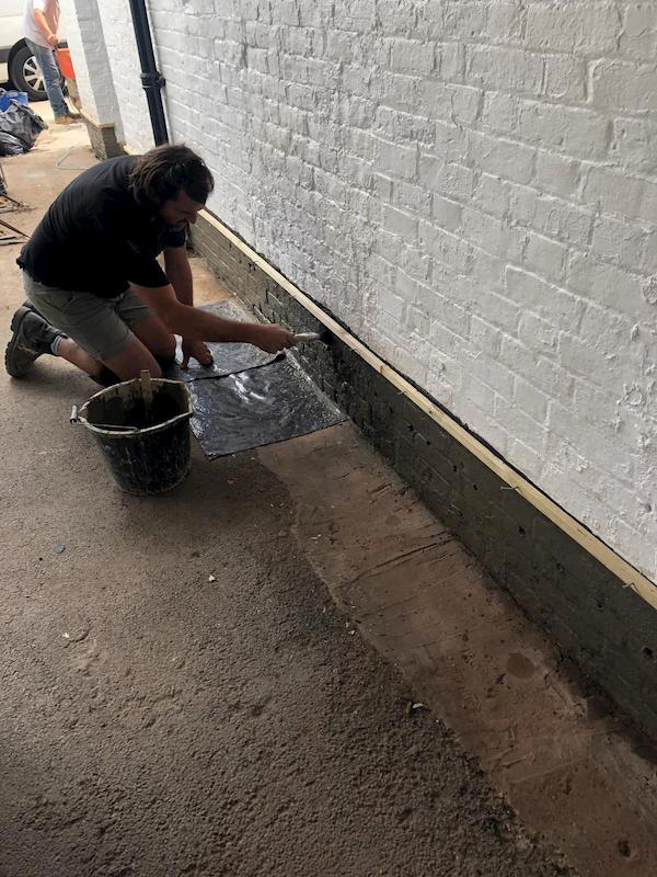 Painting the lower part black after it had been prepared.