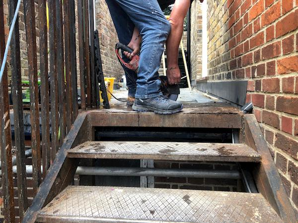 Safety tiles at the top of the wrought oiron stairs laid for safety