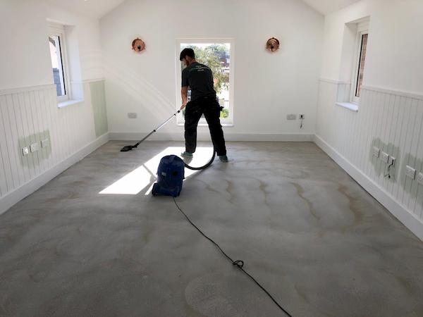 Hoovering the fllor before laying the wooden floor