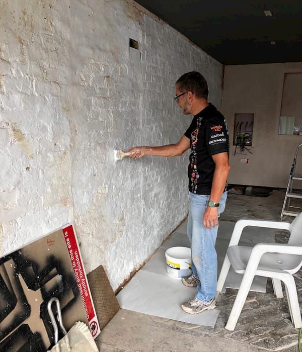 Trevor whitewashing walls