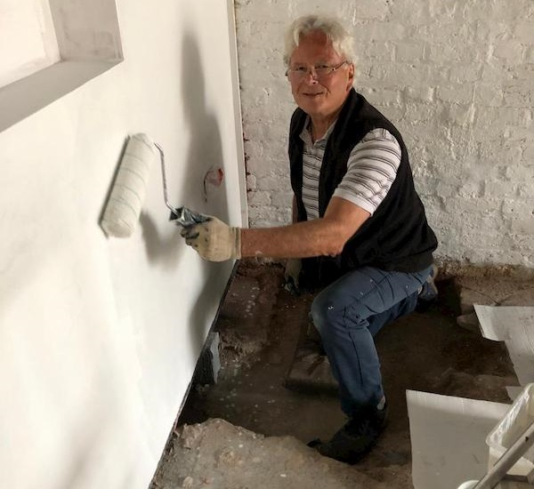 Jim whitewashing in the ground floor of The Coach House