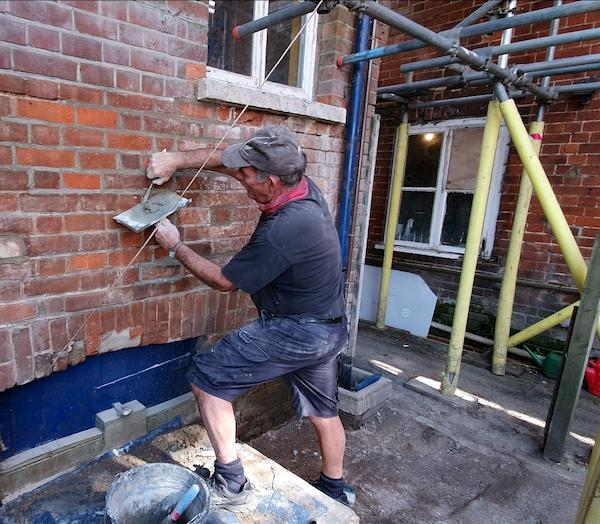 Fixing the brickwork to get rid of broken brick faces