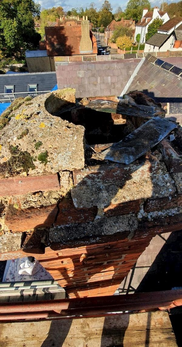 Obvous signs of damage on the top of a chimney stack