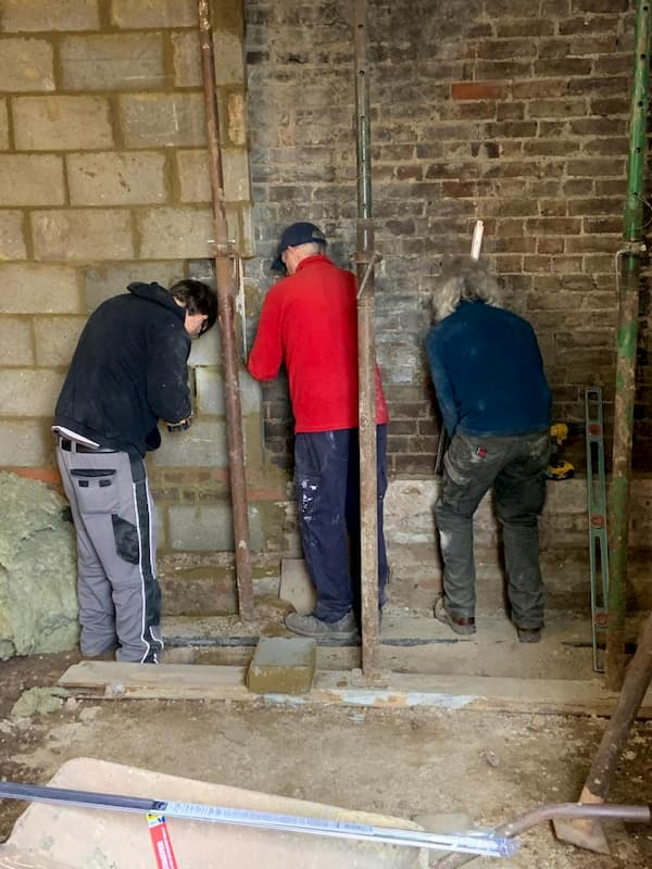 Team removing last of old back wall in The Kitchen